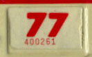 1976 (exp. 3-31-77) sticker, red on white