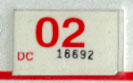 2001 (expires 2002) sticker, red on white